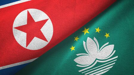 North Korea and Macau two folded flags together Stock Photo
