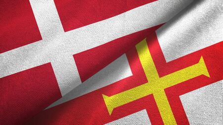 Denmark and Guernsey two folded flags together