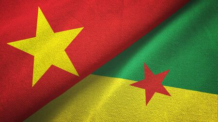 Vietnam and French Guiana two folded flags together