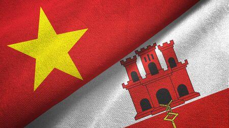 Vietnam and Gibraltar two folded flags together Zdjęcie Seryjne