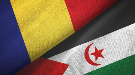 Romania and Western Sahara two folded flags together