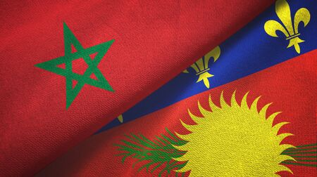 Morocco and Guadeloupe two folded flags together Zdjęcie Seryjne