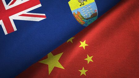 Saint Helena and China flags together textile cloth, fabric texture Zdjęcie Seryjne