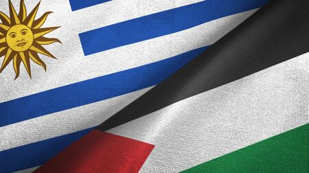 Uruguay and Palestine two folded flags together 스톡 콘텐츠