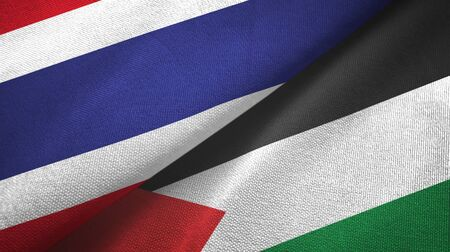 Thailand and Palestine two folded flags together