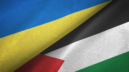 Ukraine and Palestine two folded flags together