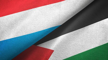 Luxembourg and Palestine two folded flags together