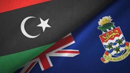 Libya and Cayman Islands two folded flags together