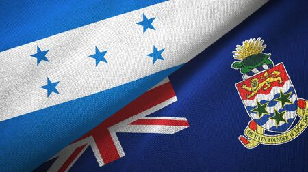 Honduras and Cayman Islands two folded flags together Stock Photo