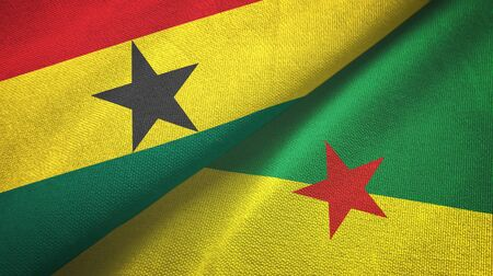Ghana and French Guiana two folded flags together