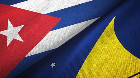 Cuba and Tokelau two folded flags together