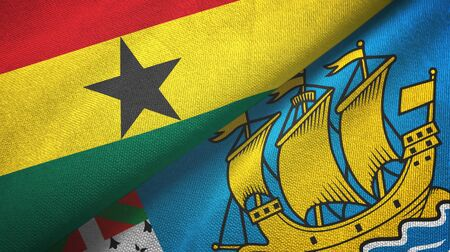 Ghana and Saint Pierre and Miquelon two folded flags together