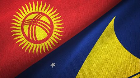 Kyrgyzstan and Tokelau two folded flags together