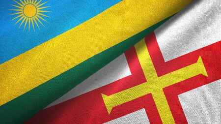 Rwanda and Guernsey two folded flags together