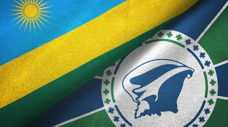 Rwanda and Martinique two folded flags together Imagens