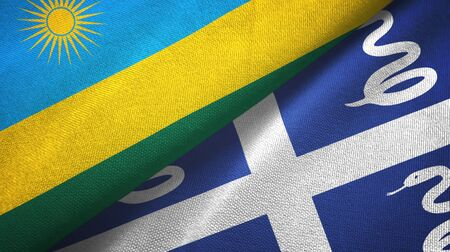 Rwanda and Martinique snake two folded flags together Imagens