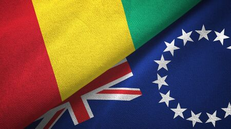 Guinea and Cook Islands two folded flags together Imagens