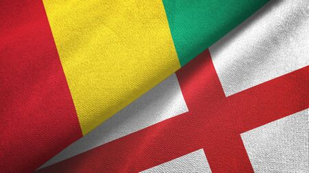 Guinea and England two folded flags together Imagens
