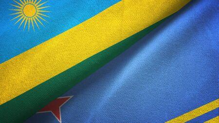 Rwanda and Aruba two folded flags together