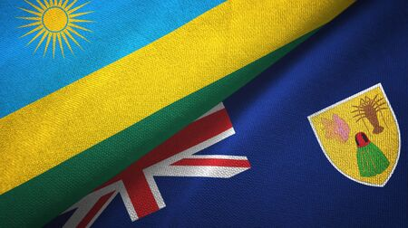 Rwanda and Turks and Caicos Islands two folded flags together Imagens