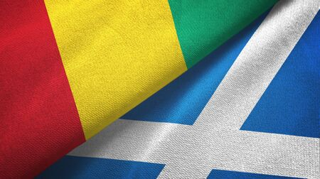 Guinea and Scotland two folded flags together