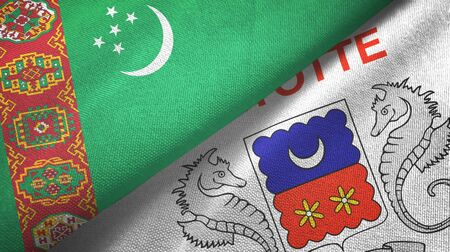 Turkmenistan and Mayotte two folded flags together