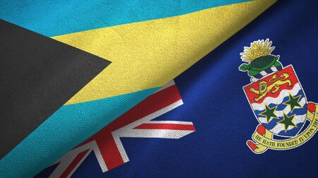 Bahamas and Cayman Islands two folded flags together Stock Photo