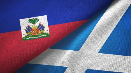 Haiti and Scotland two folded flags together Banque d'images