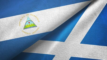 Nicaragua and Scotland two folded flags together Banque d'images