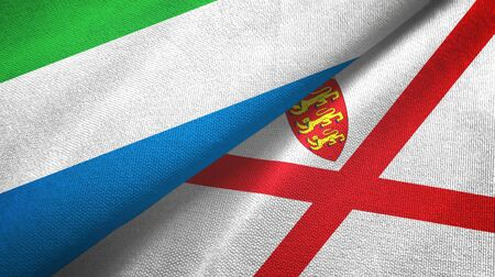 Sierra Leone and Jersey two folded flags together