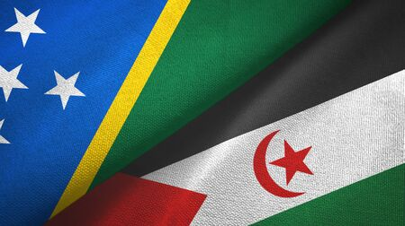 Solomon Islands and Western Sahara two folded flags together