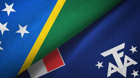 Solomon Islands and French Southern and Antarctic Lands two folded flags together Zdjęcie Seryjne