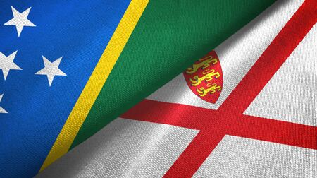 Solomon Islands and Jersey two folded flags together