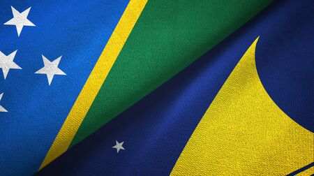 Solomon Islands and Tokelau two folded flags together