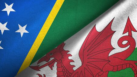 Solomon Islands and Wales two folded flags together Zdjęcie Seryjne