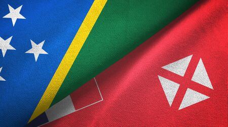 Solomon Islands and Wallis and Futuna two folded flags together Zdjęcie Seryjne