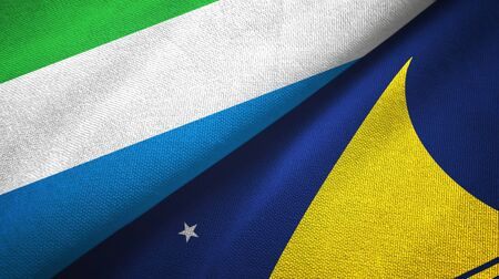 Sierra Leone and Tokelau two folded flags together