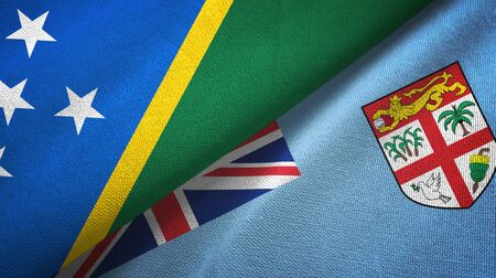 Solomon Islands and Fiji two folded flags together
