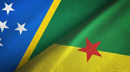 Solomon Islands and French Guiana two folded flags together