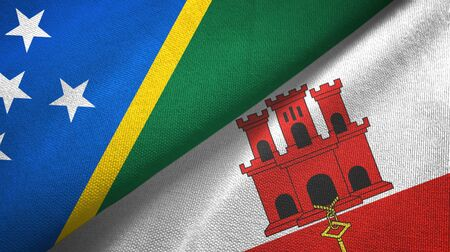 Solomon Islands and Gibraltar two folded flags together