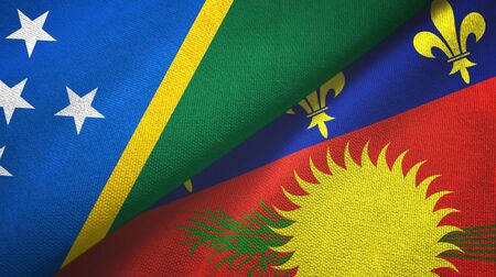 Solomon Islands and Guadeloupe two folded flags together