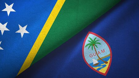 Solomon Islands and Guam two folded flags together