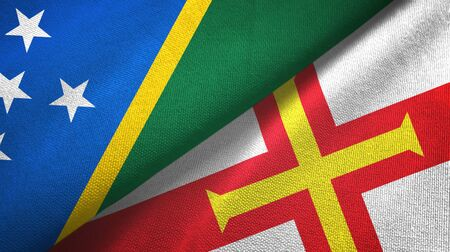 Solomon Islands and Guernsey two folded flags together