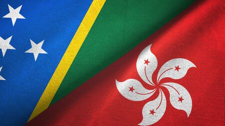 Solomon Islands and Hong Kong two folded flags together Zdjęcie Seryjne