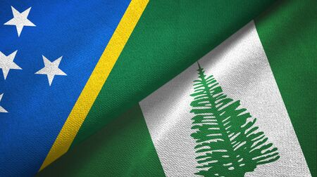 Solomon Islands and Norfolk Island two folded flags together