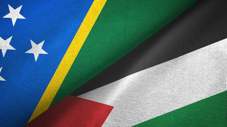Solomon Islands and Palestine two folded flags together