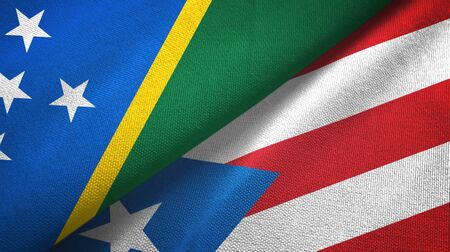 Solomon Islands and Puerto Rico two folded flags together Zdjęcie Seryjne