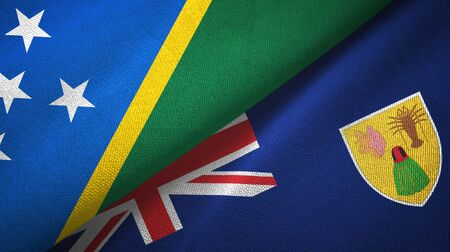 Solomon Islands and Turks and Caicos Islands two folded flags together