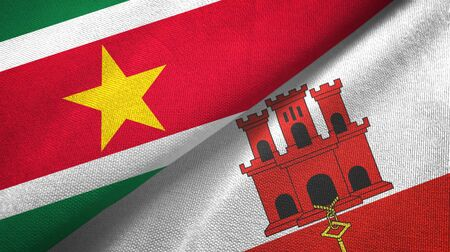 Suriname and Gibraltar two folded flags together Zdjęcie Seryjne
