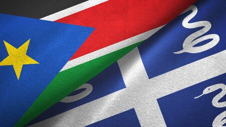 South Sudan and Martinique snake two folded flags together Zdjęcie Seryjne